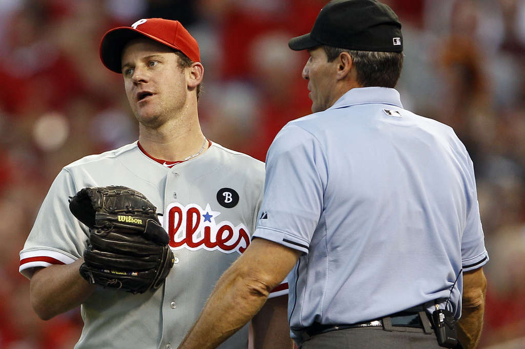 Roy Oswalt shows displeasure with plate ump Angel Hernandez over a ball call when a squirrel ran across home plate.