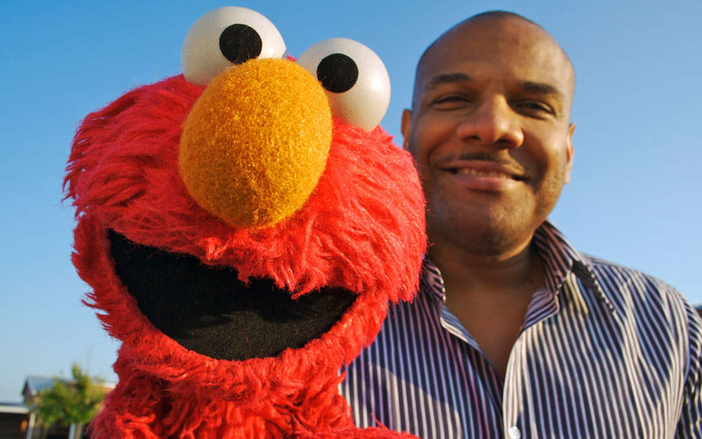 "Puppeteer Kevin Clash with Elmo, one of the cuddliest and most vivacious of the denizens of ""Sesame Street."""