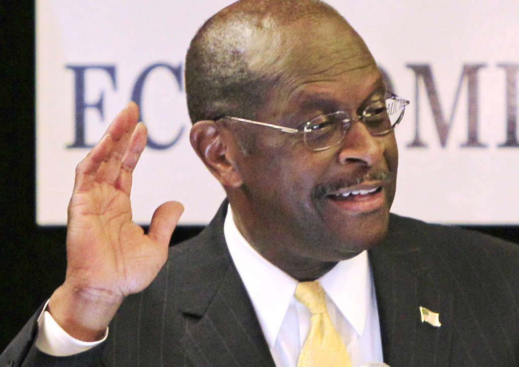 Herman Cain asks to hear from supporters during a rally yesterday in Akron, Ohio.