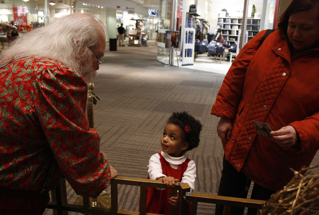Santa A. Claus greets Heather Roranteng, 3, at the Jersey Gardens Mall in Elizabeth, N.J., as she waits in line with her mother, Clara. Claus concedes that he and Mrs. Claus wanted to make their 20-year anniversary at Concord Mall next year.