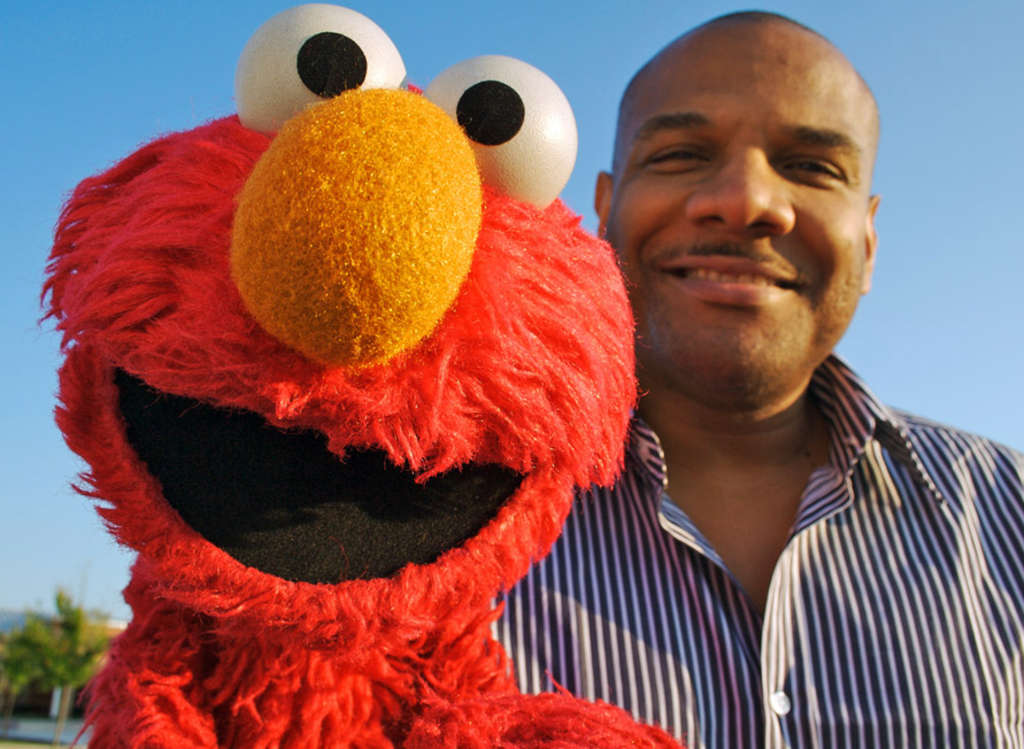 "Elmo with puppeteer Kevin Clash , who gives the cuddly, vivacious ""Sesame Street"" character his winning personality."