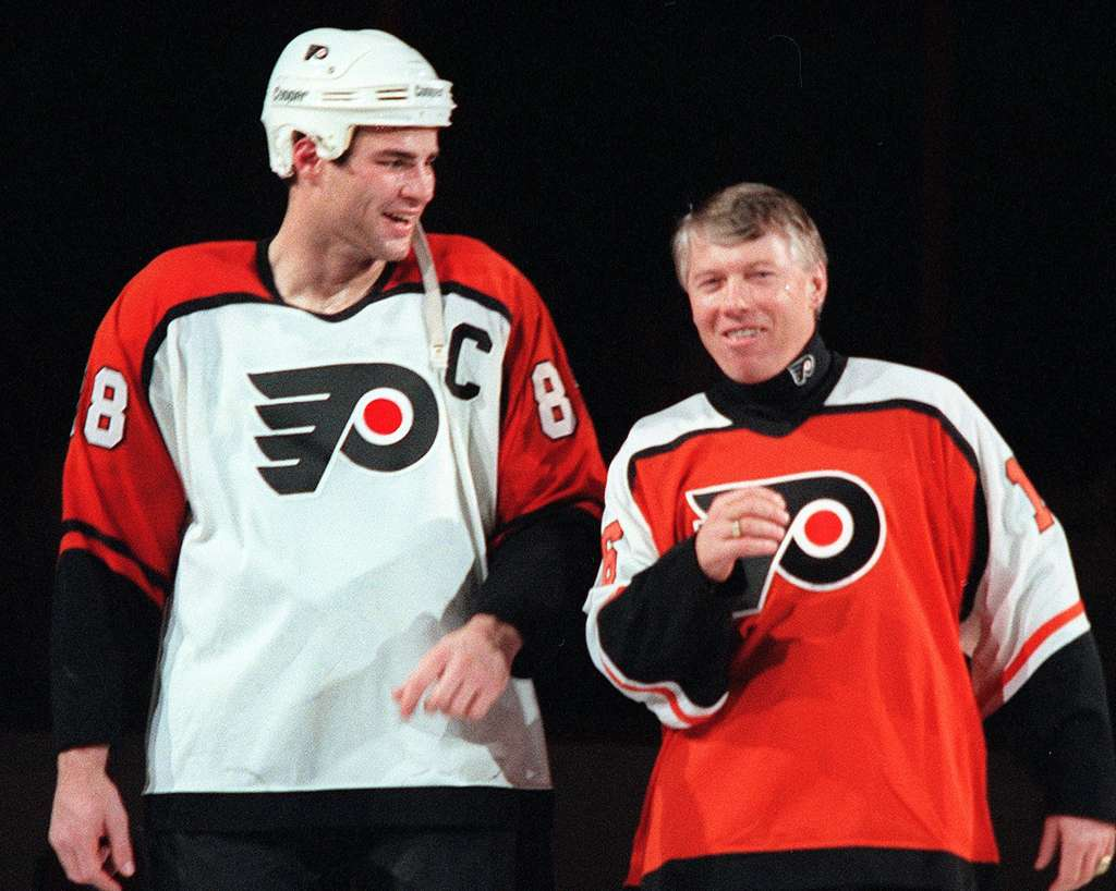 Eric Lindros and Bob Clarke (right) at the Flyers Oldtimers Night in 1996, before their relationship went south.