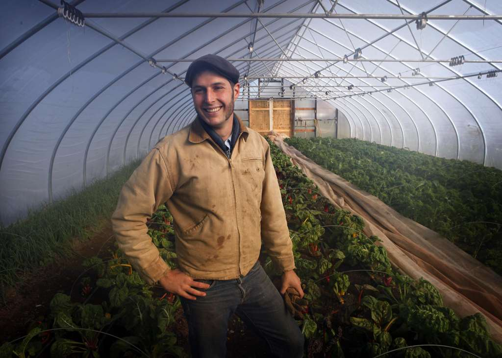 """""""Farmer Mark"""" Risso at the Longview Center. In the off-season, work continues. When he´s not checking on onions, chard, lettuce, and kale in the greenhouse or high tunnels, he´s repairing tool handles, whacking weeds, or perusing online seed catalogs."""