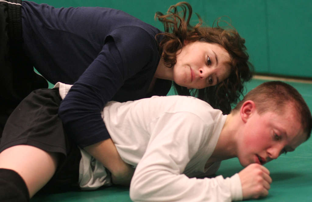 """Ridley junior 106-pounder Cass Ferrell works out with freshman Sean Cannon at practice. """"She´s a good wrestler. She´s quick,"""" Cannon said, adding: """"I treat her like a boy."""""""