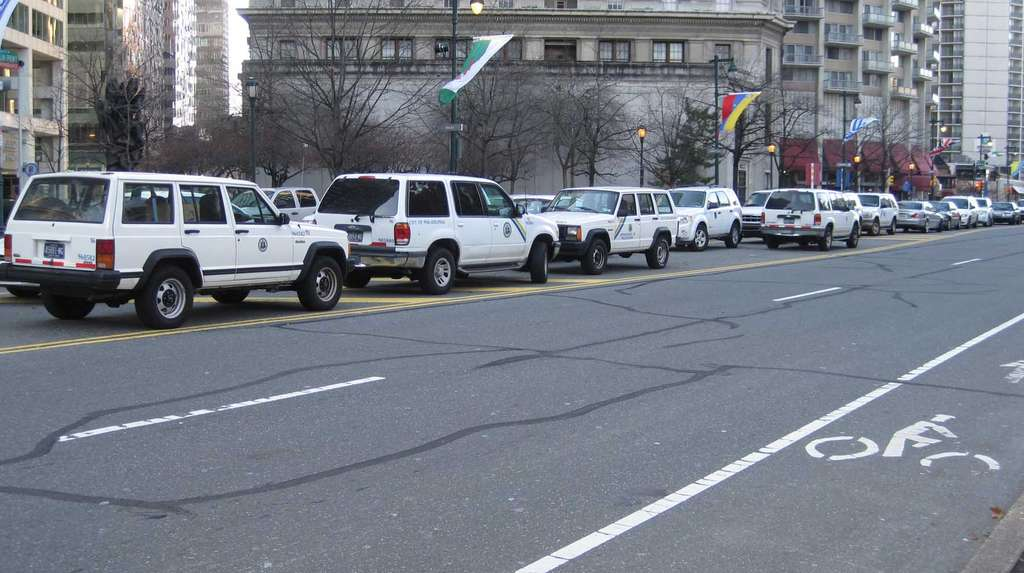 Despite alleged warnings and its basic unlawfulness, parking of city cars continues along the Parkway median.