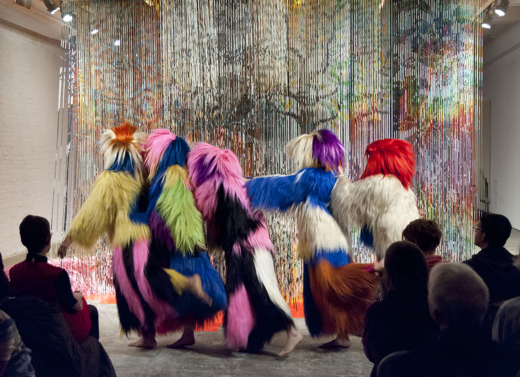 """Architectural Forest"" opened Nick Cave´s exhibition at Fabric Workshop and Museum with dancers and musicians in an environment of shimmering bands of painted bamboo."