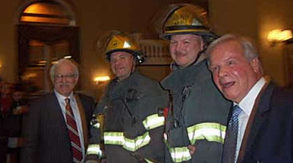 Jim Gardner (left) and Dave Roberts flank Philly firefighters.