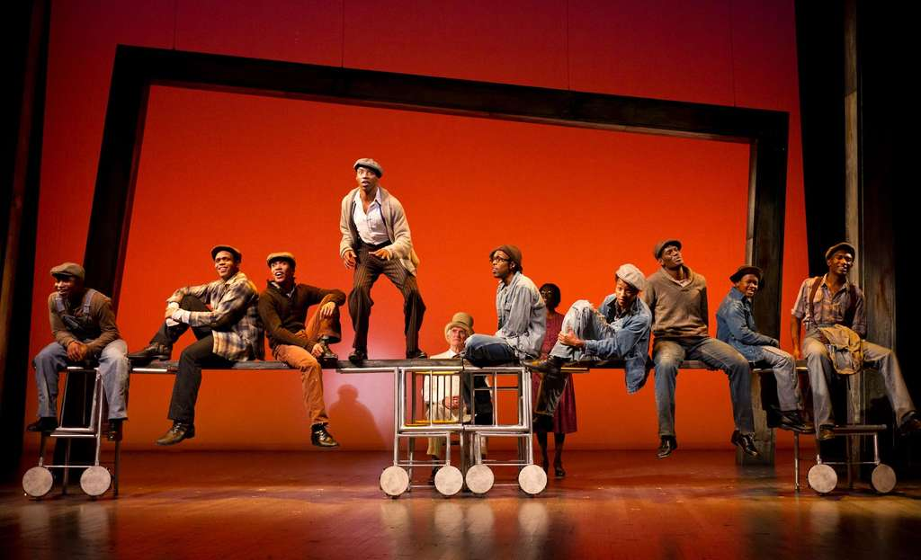 """The cast of """"The Scottsboro Boys"""" onstage at the Suzanne Roberts Theatre. The musical tells the story of nine black youths who were falsely accused of rape in 1931."""