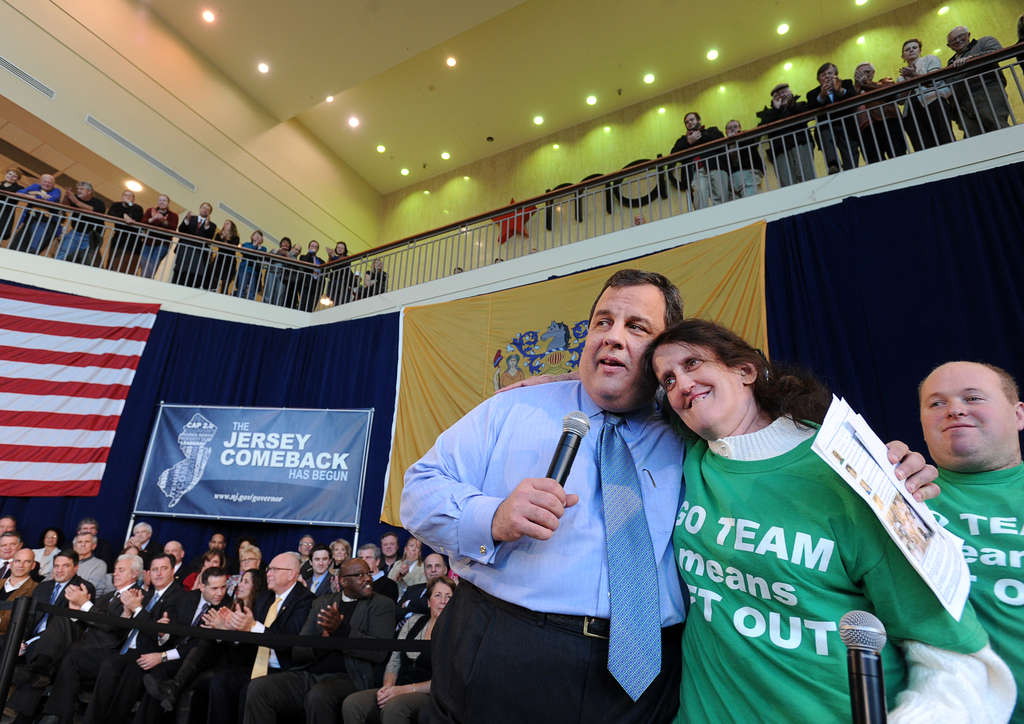 Gov. Christie hugs Kim Coll, with Joey Meitz nearby. Staffers advised arriving an hour early, and they were not kidding.