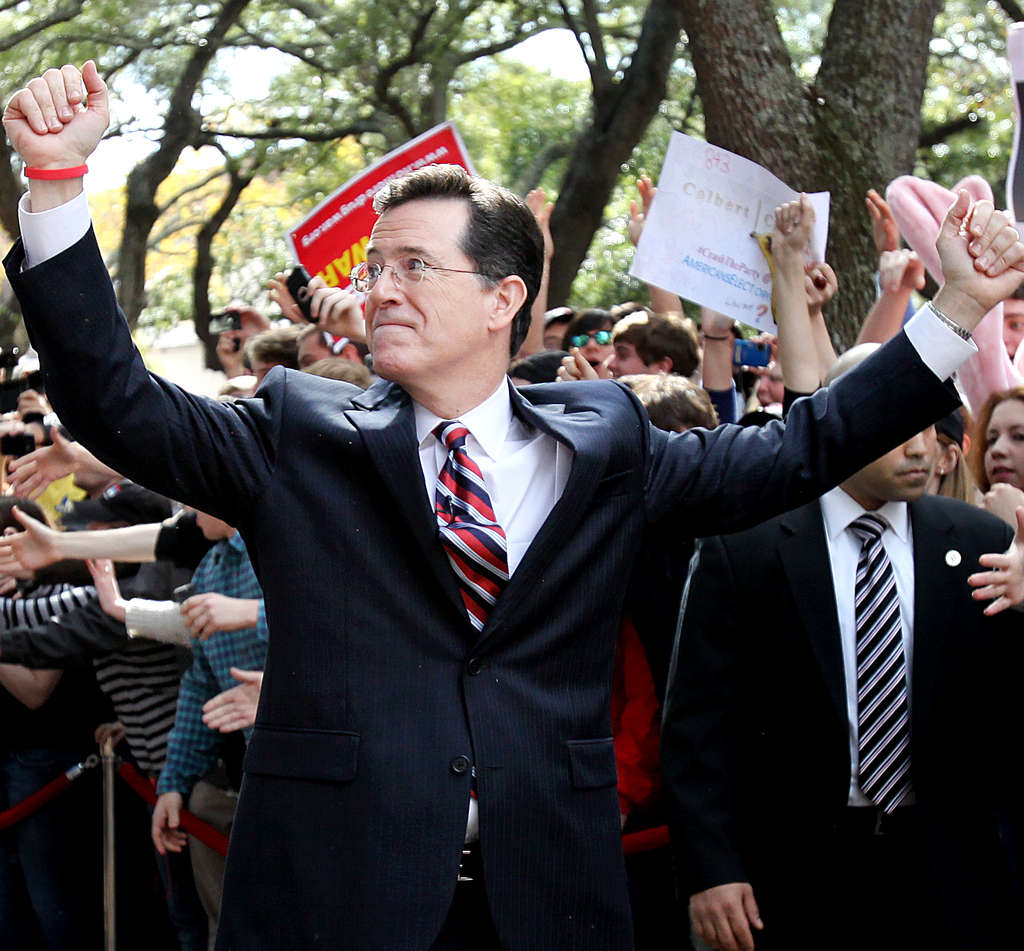 """Stephen Colbert at the """"Rock Me Like a Herman Cain South Cain-olina Primary Rally."""""""