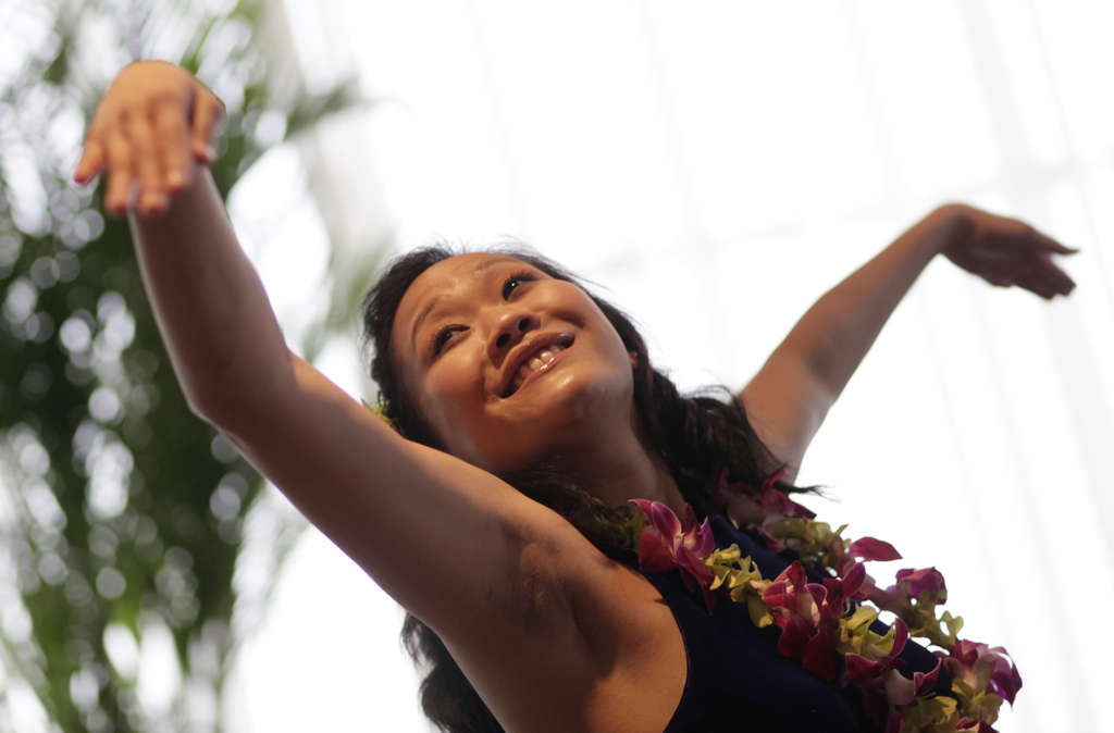 During a preview presentation on the Phila. Flower Show, opening March 4, Kimi Artitia of Aloha Style does a hula dance.
