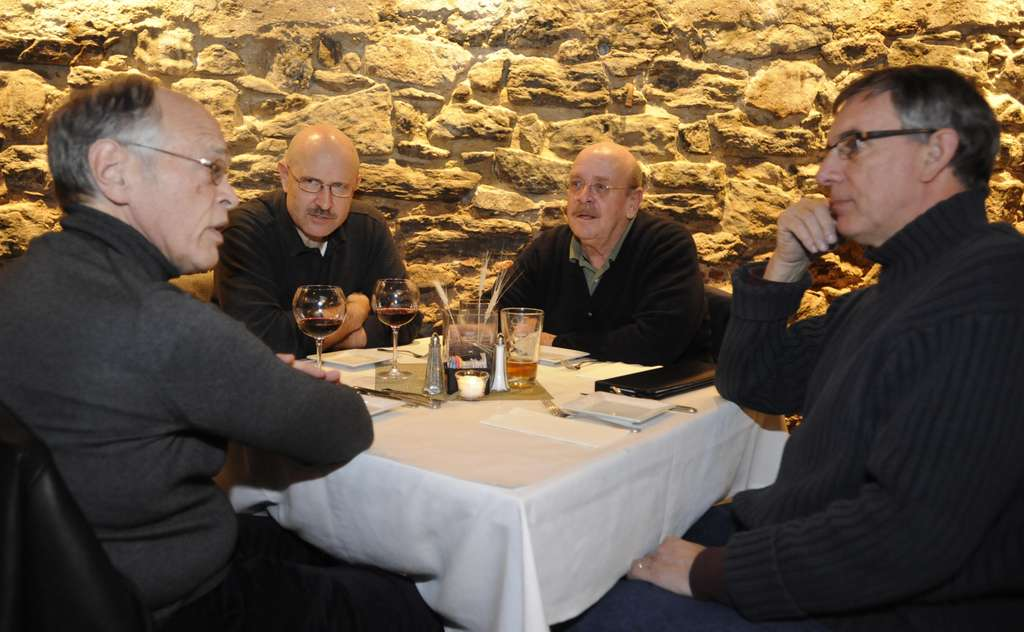 Gathering for their twice monthly conversation at the Manayunk Brewery and Restaurant are (from left) Tom Casey, Ted Glackman, Tom Talone, and Myles Pettengill. Serious matters take precedence over chitchat when the group meets.