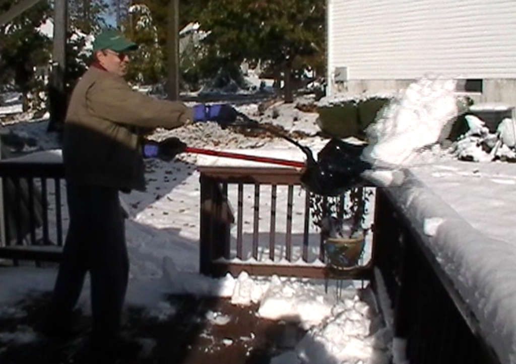 """Downingtown inventor Howie Rosenshine uses his two-handled """"Shovelution."""" (Slogan: """"Let your shovel do the bending."""")"""