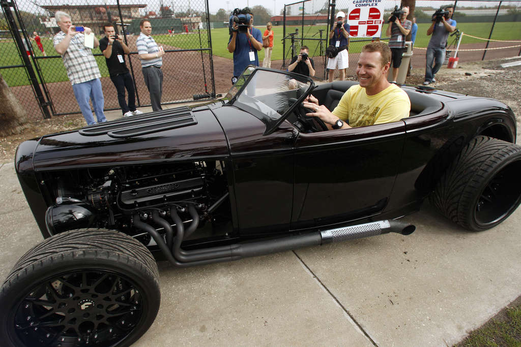 Phillies ace Roy Halladay leaves a workout at Bright House Field in his hot rod.
