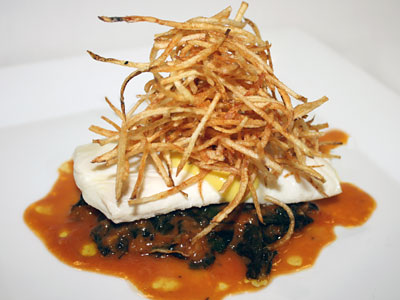 Poached Pacific halibut filet (with tomato-orange braised lacinato kale, saffron aioli, pommes alumettes) by Chris Calhoun.