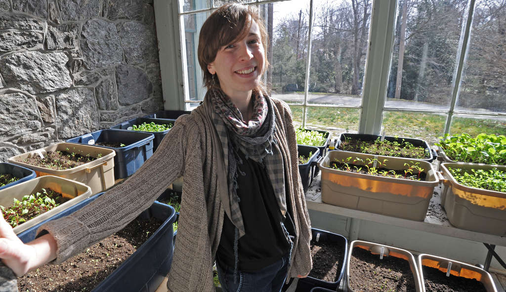 Beth Miner, Awbury´s manager of outreach and community engagement, in the solarium of the Francis Cope House. The plants are part of an arboretum program at a local preschool. She´s trying to connect with local groups, community centers, nonprofits.