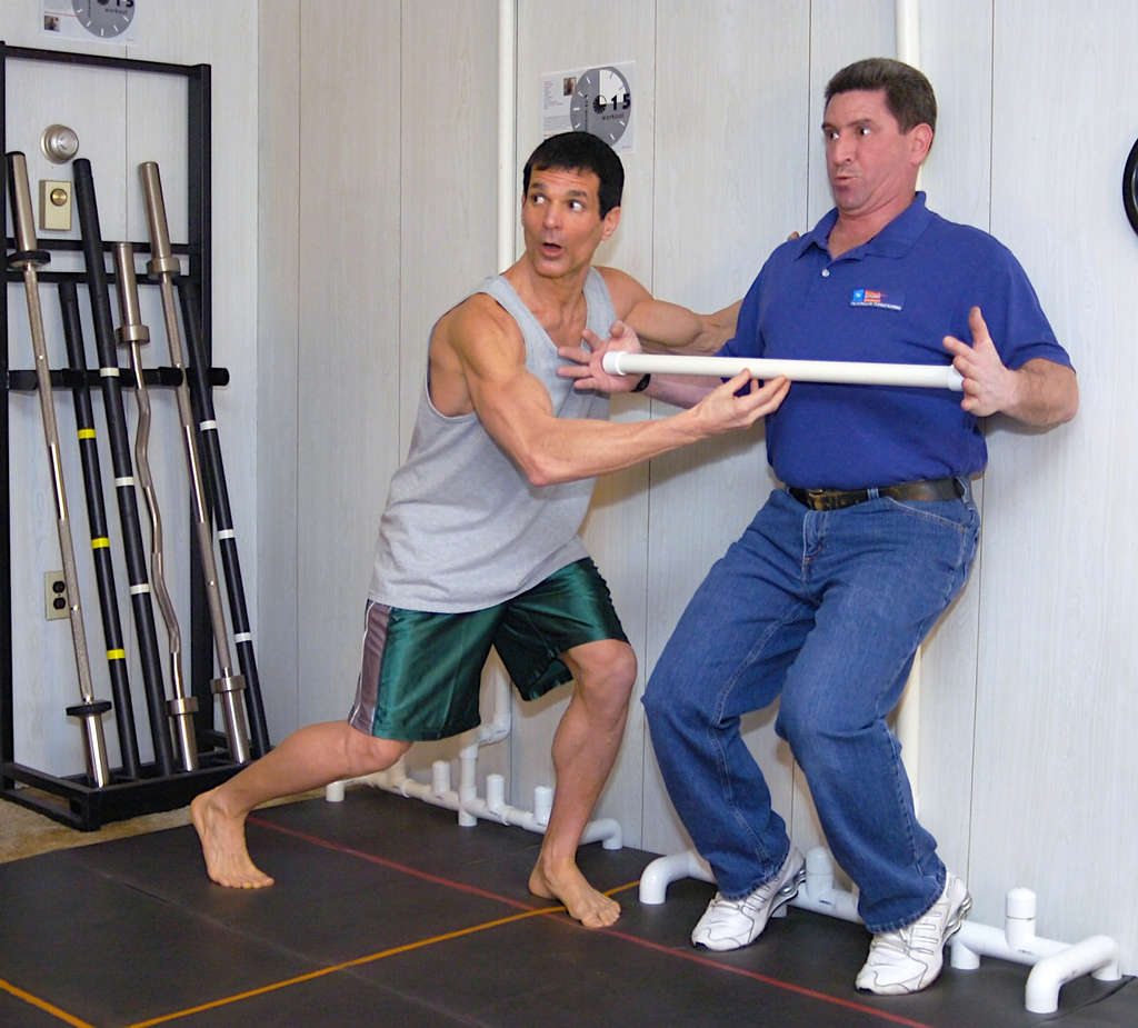 Mike Barretta (left) works with a client, Anthony Iacaruso, who says he´s lost weight, has better posture, and feels less tired.