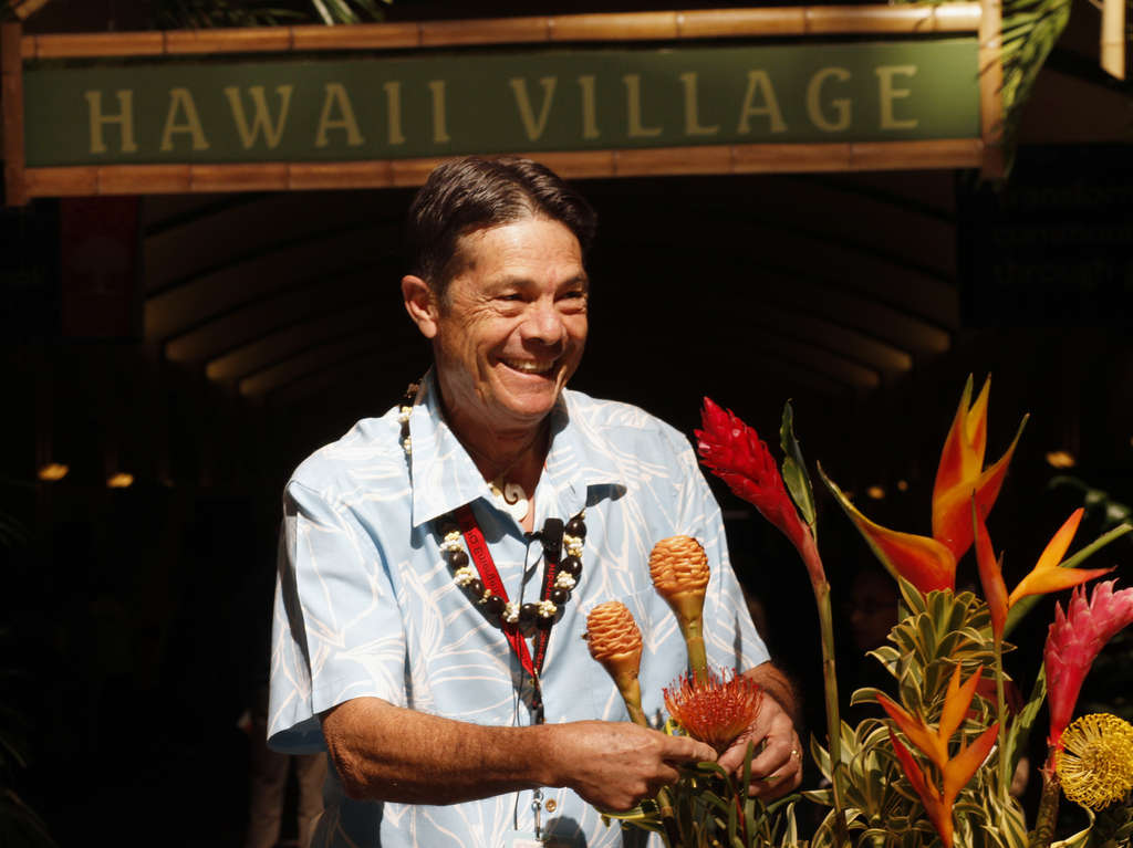At the Flower Show´s Hawaii Village, Johnny Gordines discusses tropical plant care. The village, in the show´s Grand Hall, also features hula dancers, musicians, and crafts.