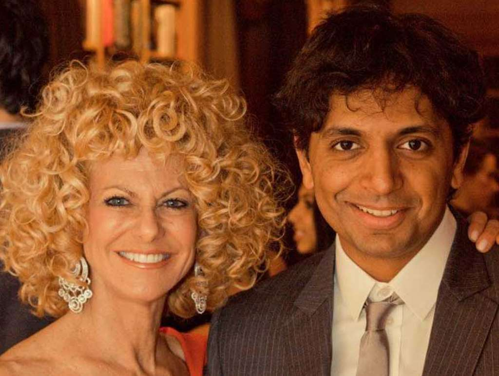 Sharon Pinkenson, head of the Greater Philadelphia Film Office, with M. Night Shyamalan, at a party at his house Saturday toasting her for her two decades running the office.