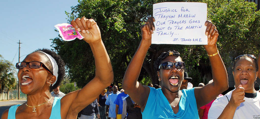 Phoebe Denson (left) and Myrtle Hudson march Sunday in Titusville, Fla., demanding justice over the Trayvon Martin killing. FloridaToday.com
