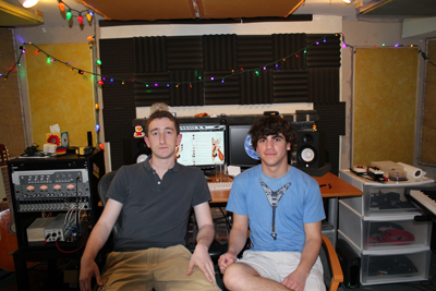 Jake Goodman (left) and Stefan Richter (right) sit in Richter´s basement, where they record and edit tunes as BamBam Studios.