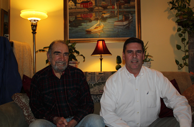 Dan Cavaliere, Sr. and Jr. (left to right) sit under an oil painting of Kennybunport, Maine, created by the late R.J. Cavaliere. (Josh Fernandez/ Philly.com)