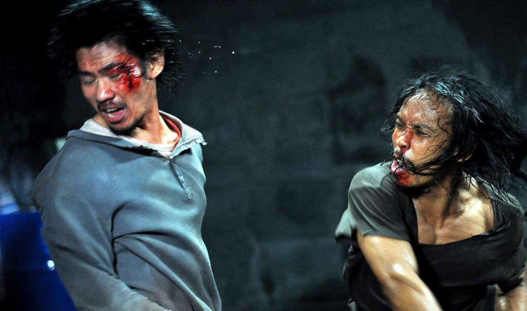 "(left) and Yayan Ruhian in ""The Raid: Redemption."" Surprisingly, it has a pretty good plot. AKHIRWAN NURHAIDIR"