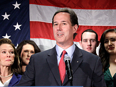 "Joined by family members, former U.S. Sen. Rick Santorum announces in Gettysburg that he will suspend his campaign for the GOP presidential nomination. Still, he said, ""we are not done fighting."" GENE J. PUSKAR / Associated Press"