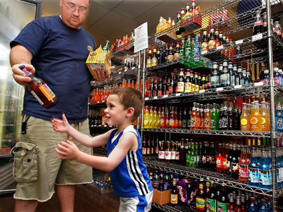 Hold the lectures about mountains of sugar, tons of empty calories and loads of artificial ingredients. A new study from Belgium suggests that parents can rein in the amount of soda their kids consume with three steps. (AP Photo)