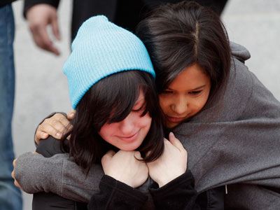 Alyssa Rodemeyer, 16, of Buffalo, N.Y., is hugged by Raina Pope, of Sebastopol, Calif., after Rodemeyer spoke about her 14-year-old brother Jamey during an Anti-Bullying rally on the steps of City Hall, Monday, Feb. 20, 2012, in San Francisco. Jamey Rodemeyer committed suicide in September 2011 as a result of bullying. (AP Photo / Marcio Jose Sanchez)