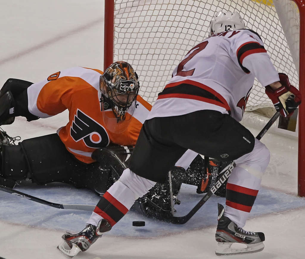Ilya Bryzgalov prevents a goal by New Jersey´s Alexei Ponikarovsky in Game 2 at the Wells Fargo Center. The Flyers need to win on the road Thursday to regain the series lead.