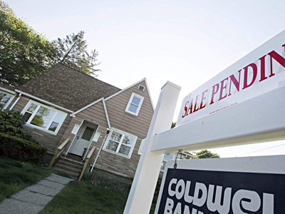 For-sale sign. BILL SIKES / Associated Press
