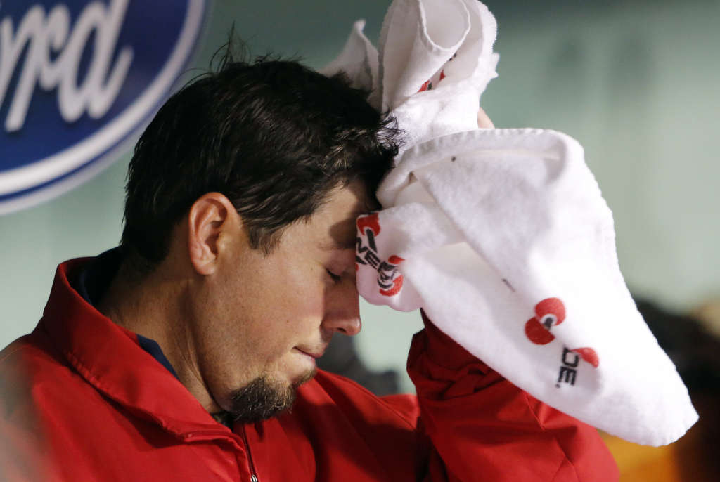 Red Sox pitcher Josh Beckett , who over-indulged during games last year, is sweating it out again. MICHAEL DWYER / AP