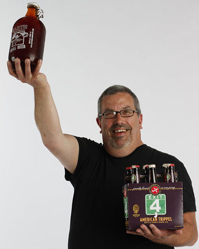 Judge Tom Peters holds the two winning brews, New Beer (left) Amarelle Belgian-style sour cherry ale, Earth, Bread & Brewery growler and Philly Classic Exit 4 American trippel, Flying Fish Brewing Co.; 12 oz. (David M Warren / Staff Photographer)