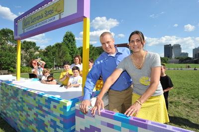 Alex´s Lemonade Stand Foundation´s Liz and Jay Scott, Alex´s parents, build the world´s largest LEGO lemonade stand along with LEGO Friends near the Constitution Center in Philadelphia.