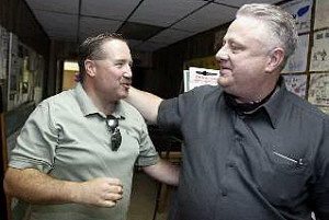 Union members Charles Wilson, left, and Bill Rachubinski greet each other a meeting with Gov. Corbett at the Oil, Chemical &amp; Atomic Workers International Union Hall in Marcus Hook.<br />( AKIRA SUWA  /  Staff photographer )