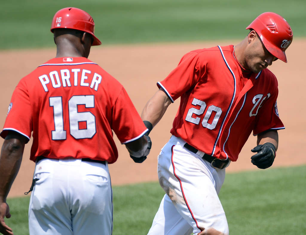 Ian Desmond (passing coach Bo Porter) can hit home runs - while saying he´s hurt and can´t make the All-Star Game .CHUCK MYERS /MCT