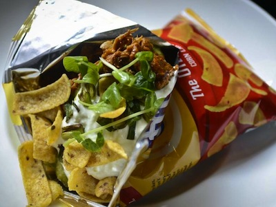 Tacos in a bag made with Fritos and pulled pork, at Square Peg restaurant at 10th and Walnut in Center City. (RON TARVER / Staff Photographer )