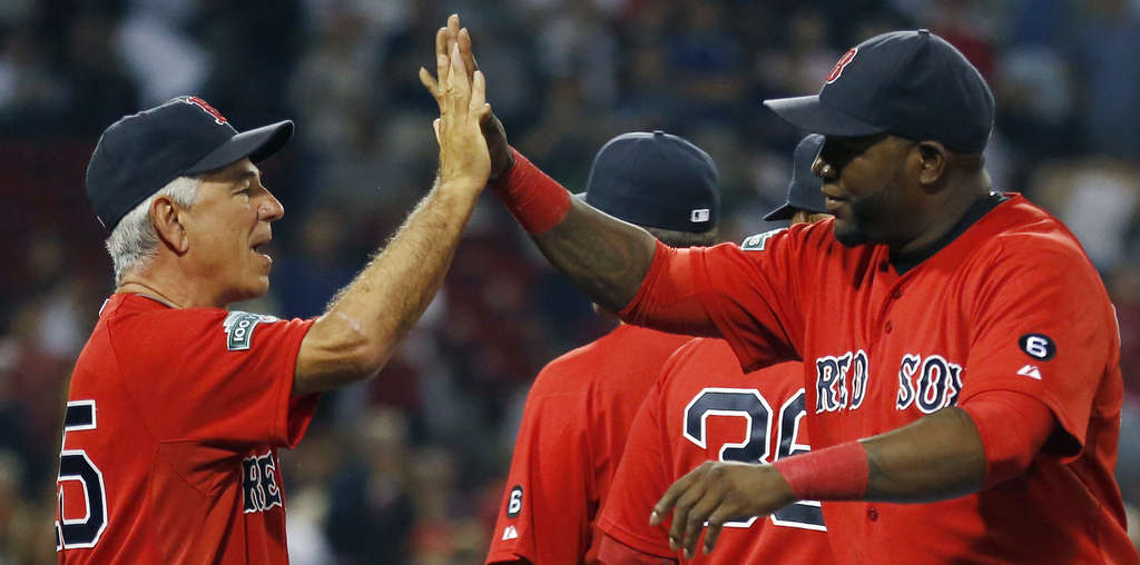 Boston´s David Ortiz (right), high-fiving Bobby Valentine, hopes to return this season and in 2013.