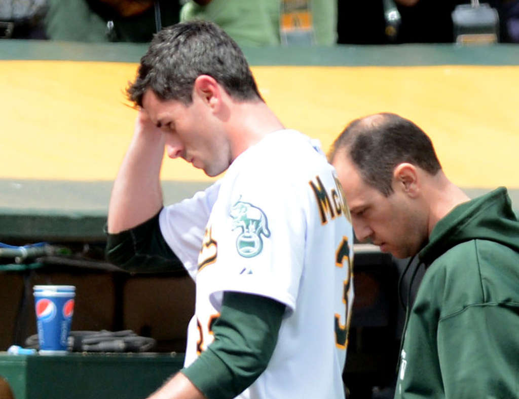 A´s pitcher Brandon McCarthy leaves the field after being hit in the head Wednesday.
