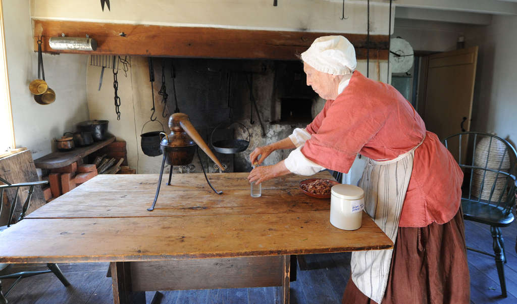 Clarissa Dillon, 79, sets up a mini-still, to make rose water for cooking use, at the Thomas Massey House.