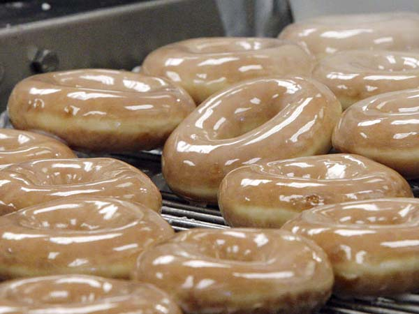 Krispy Kreme doughnuts get glazed as they come down the production line.