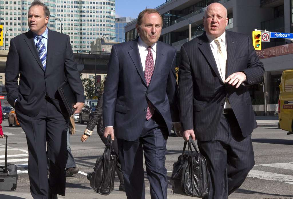Just in time for latest round of talks, commissioner Gary Bettman (center) has posted CBA details for all to see.