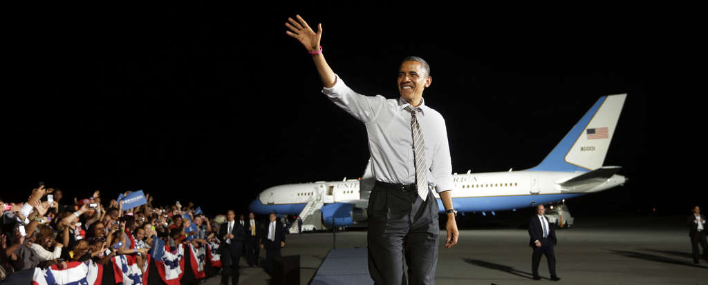 President Obama waving to supporters at the Cleveland airport Thursday.