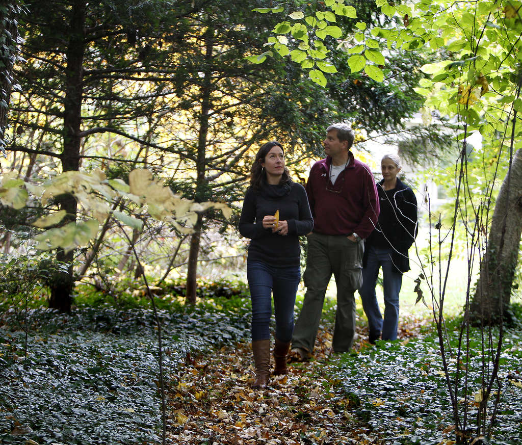 Horticulturalist Nicole Juday (left), who found one of Jellett´s notebooks, walks at Awbury with Mark Sellers and Claudia Levy of the arboretum board.
