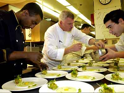 Marcus Samuelsson (left), then of New York&acute;s Aquavit, working with Martin Hamann (center), at the time chef at the Fountain Restaurant, on a course for the New Scandinavian lunch they served in 2004. VICKI VALERIO / Staff Photographer<br />
