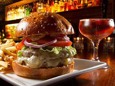 """Burgers and Bubbles"" pairs a double burger with a glass of brut ros&#0233 at The Industry.  DAVID M WARREN / Staff Photographer"