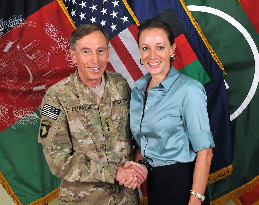 Gen. David H. Petraeus shaking hands with Paula Broadwell in a photo from July 2011.