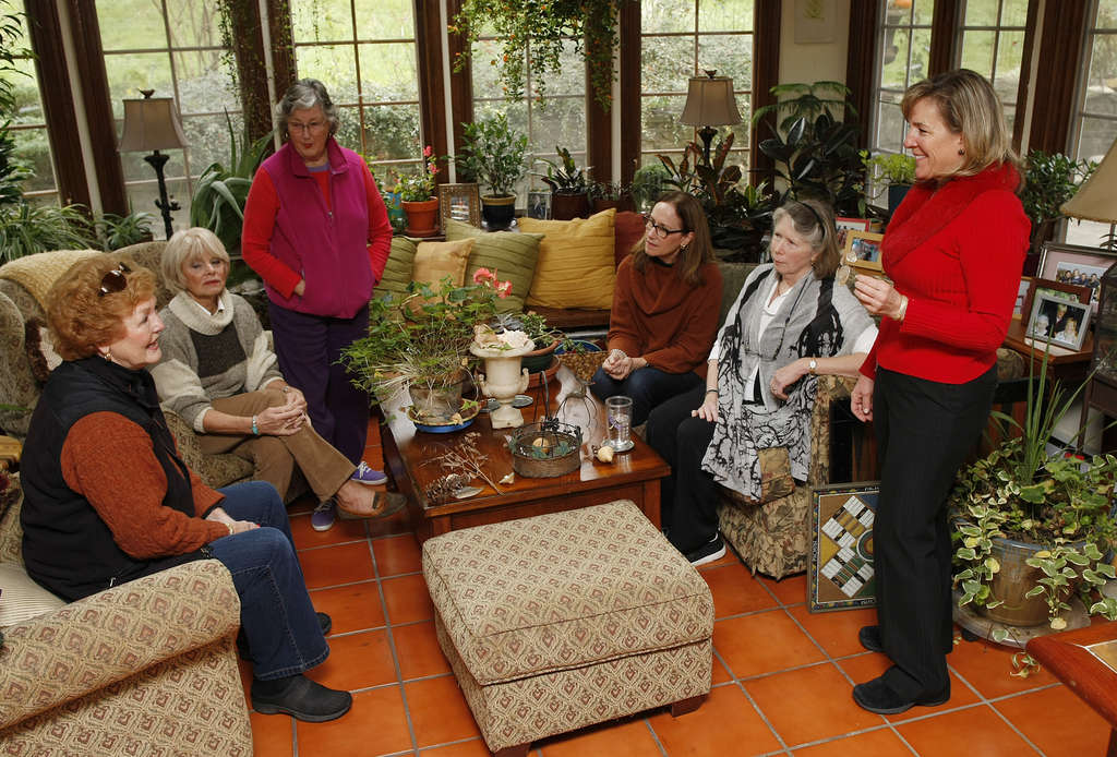 Mandy Swope (right) explains some of her ideas for holiday decorations to (from left) Sandy Hulett, Marty Devenney, Margo Bennett, Katherine Bennett, and Pam Smyth. Swope recovered from the death of her husband thanks to time, therapy, gardening, and the friendship of gardeners.