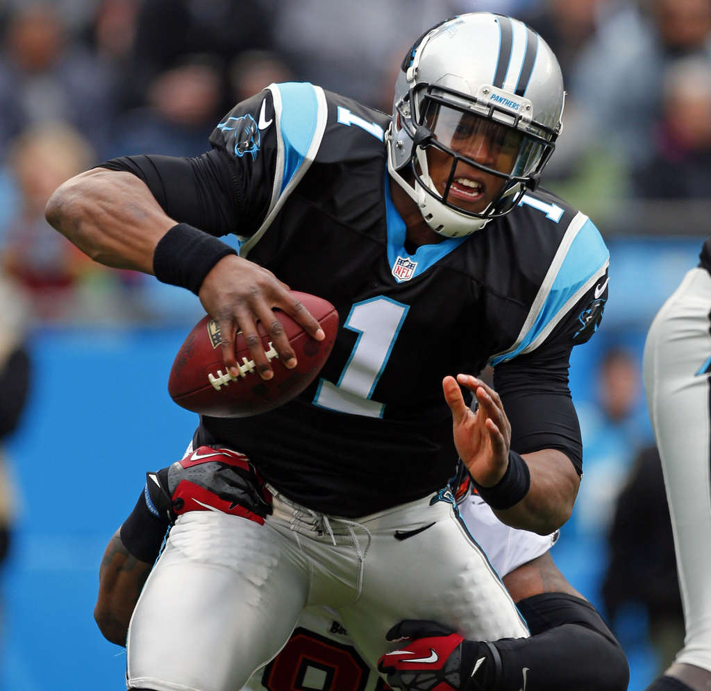 Quarterback Cam Newton was hailed as the centerpiece to turning Carolina around as a No. 1 pick in 2011. Instead, the Panthers are battling the Eagles for the worst record in the NFC. BOB LEVERONE / AP